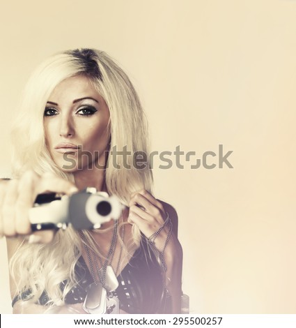 Beautiful blonde woman  shooting gun