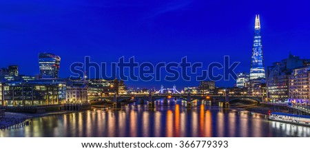 Beautiful blue sky on the Thames River with the Shard in the background, view from London Millennium footbridge, London, United Kingdom.