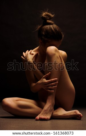 image Young girl meditates naked and does acrobatic exercises