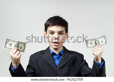 beautiful boy holds money