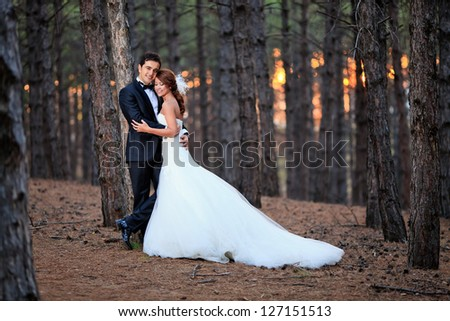 beautiful bride with a handsome groom at the forest