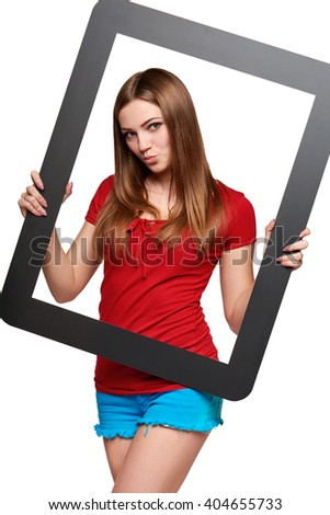 Beautiful bright girl standing looking through the frame, over white background