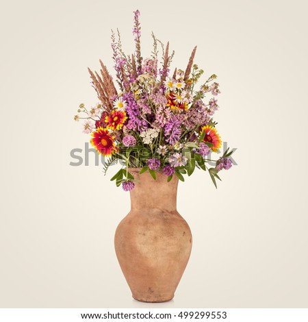 Beautiful Bright Wild flowers bouquet in vase. Holiday symbol