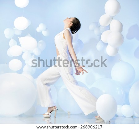Beautiful brunette beauty on balloon background