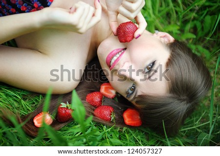 Beautiful brunette girl with strawberry