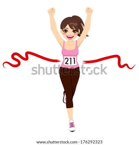 Beautiful brunette woman crossing red finish line and celebrating victory with fists up
