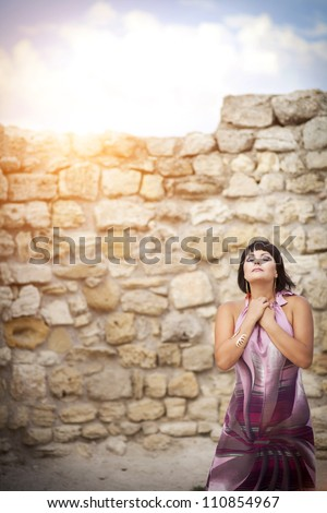 beautiful brunette woman posing at Ancient wall of ruined city Hersones-Crimea.attractive slim sexy brown hair girl outdoor. Alluring lady with short hairstyle. Freedom and lifestyle concept.series