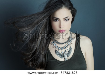 beautiful brunette woman with silver necklace, natural look beauty portrait