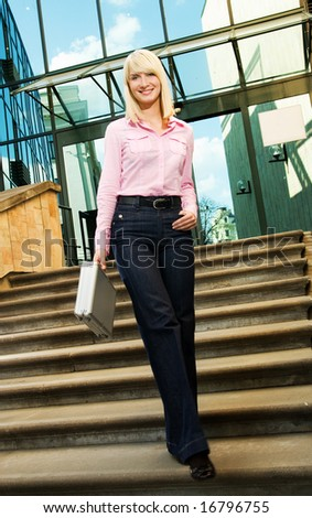 Beautiful business woman near the office building