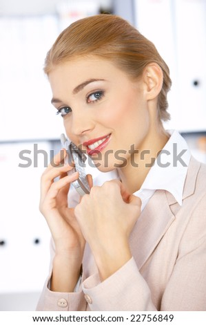 Beautiful business woman talking cell phone and smiling
