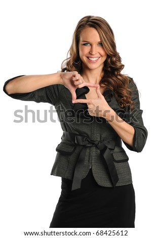 Beautiful businesswoman making frame with hands isolated over white background