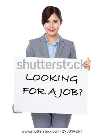 Beautiful businesswoman showing a board showing with looking for a job phrases