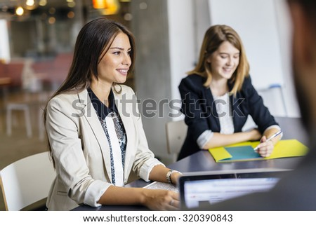 Beautiful businesswoman working in office and smiling