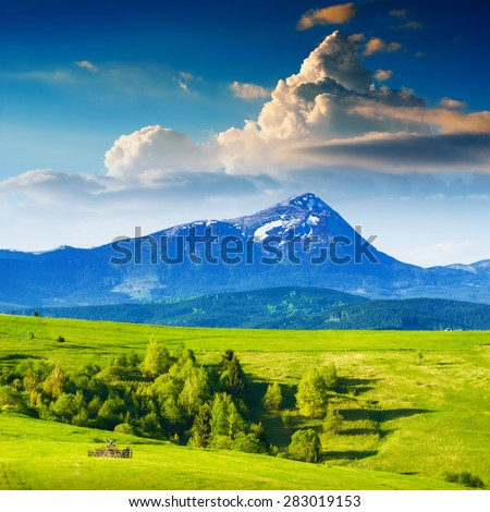 Beautiful Carpathian mountain valley under the Hoverla, higher mountain of Ukraine, with colorful clouds in a sunset light.