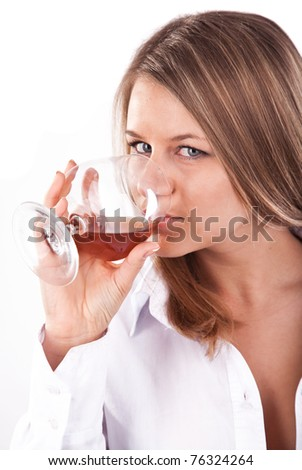 Beautiful caucasian lady making a gulp of cognac