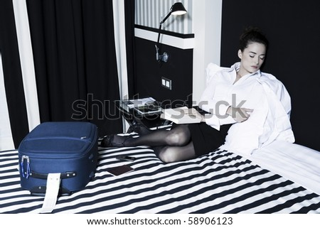 beautiful caucasian woman read doze in a hotel bedroom