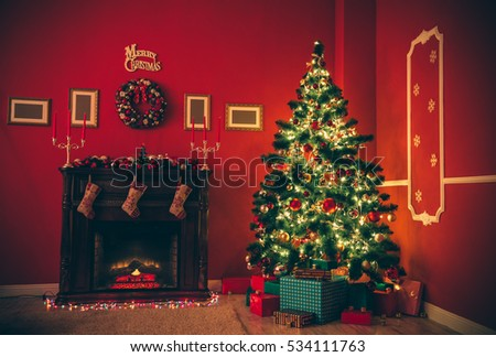 Beautiful Christmas living room with decorated Christmas tree, gifts and fireplace a night with of glowing lights. The idea for postcards.