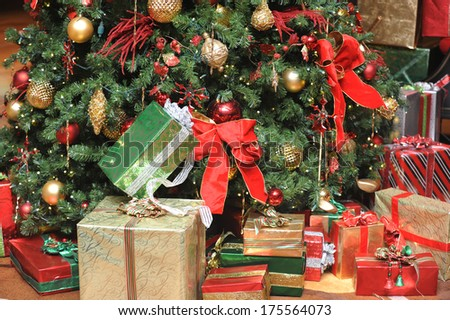 Beautiful Christmas presents in front of the tree