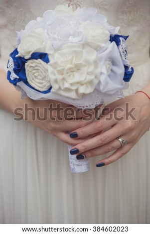 Beautiful civil wedding bouquet, hand made. Focus on hands