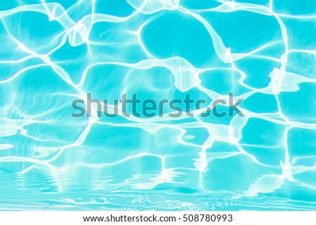 Beautiful clear pool water reflecting in the sun background.