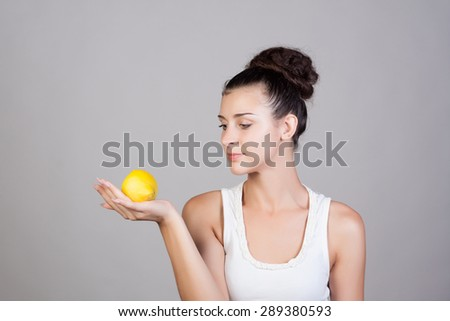 Beautiful close-up young woman with lemons. Healthy food concept. Skin care and beauty. Vitamins and minerals.