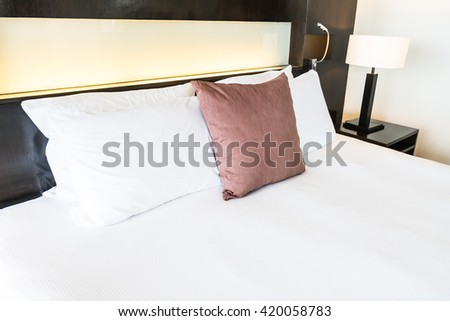 Beautiful comfort pillow on bed decoration in bedroom interior - Vintage light Filter