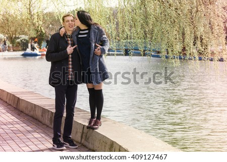 beautiful couple in love walking in the park, spring season - Romantic date outdoors