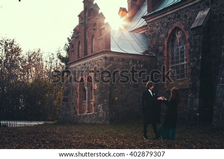 beautiful couple in  sunset time in a castle