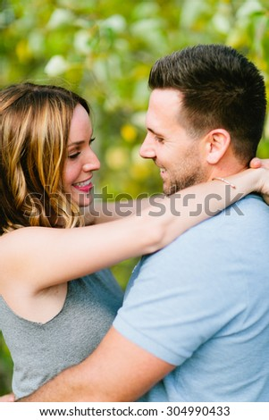 Beautiful Couple in Wheat Field Looking at Each Other
