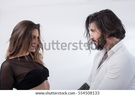 Beautiful couple looking at each other on white background