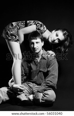 Beautiful couple on black background. Classical black and white art-photo.