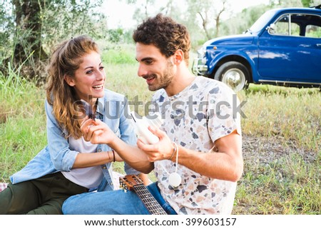 Beautiful couple taking a selfie having a picnic