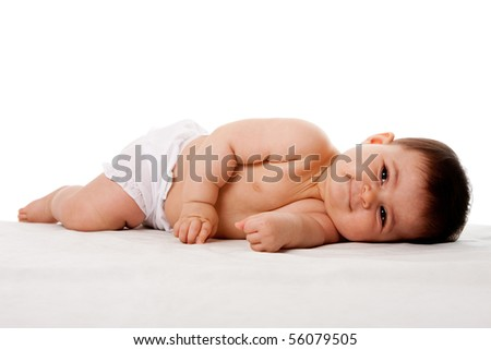 Beautiful cute peaceful tired happy baby laying on side, isolated.