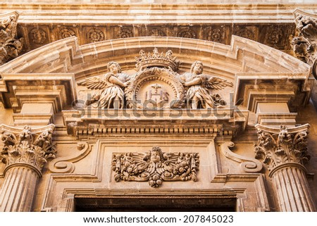 beautiful decoration above entrance to the building in baroque style in Siracusa, Sicily, Italy