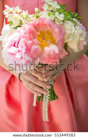 Beautiful engagement flowers bouquet focus on hands