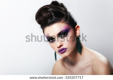 Beautiful face of young adult woman with clean fresh skin. Beauty Model Woman Face. Perfect Skin. Professional Make-up.Makeup. Fashion Art. Vogue Style.