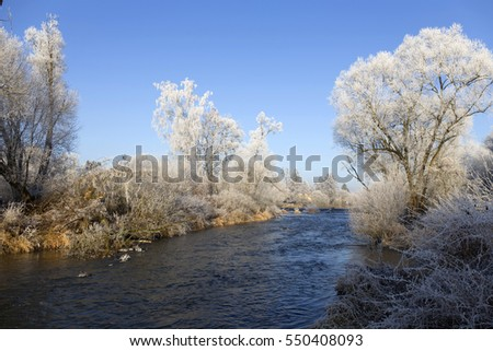 Beautiful fairytale snowy winter countryside with blue Sky along the river Sazava in Central Bohemia, Czech Republic