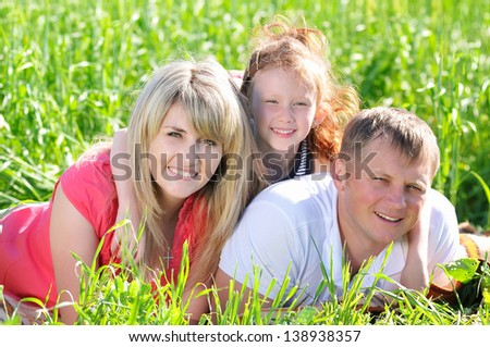 Beautiful family outdoors in a green field