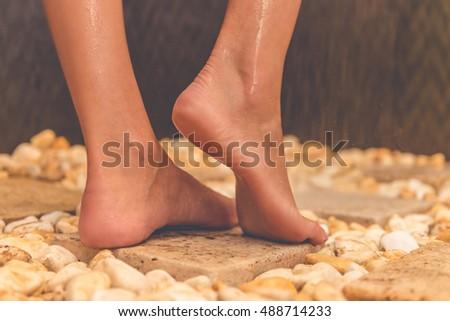 Naked girl in shower barefoot