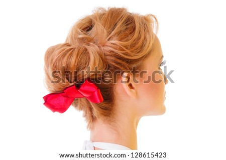 beautiful female hair with a red bow. blonde hairstyle isolated on white background