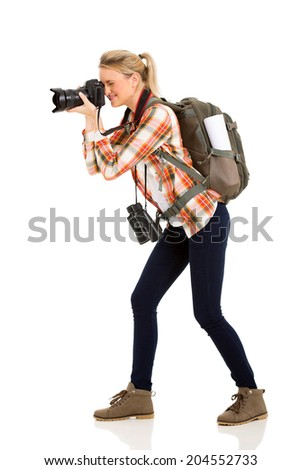beautiful female tourist taking photos with digital camera