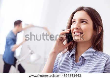 Beautiful female worker is using a telephone