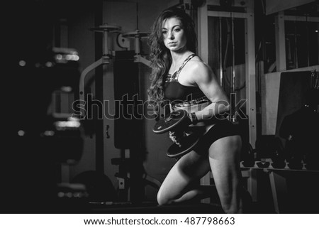 Beautiful fitness girl exercising in the gym Black & White
