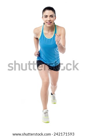 Beautiful fitness woman jogging over white