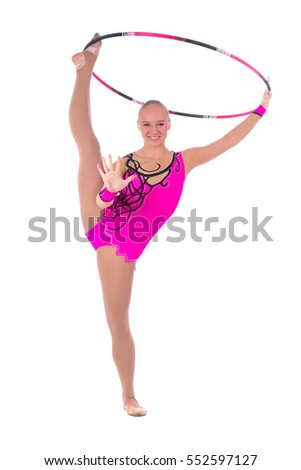 Beautiful flexible girl gymnast staying on one leg up with hoop over white background