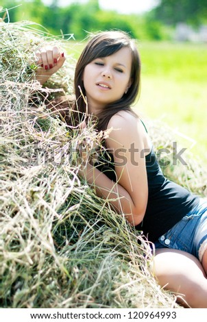 Beautiful girl and hay