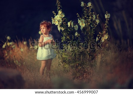 beautiful girl at sunset holding flowers in their hands