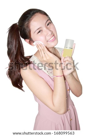 Beautiful girl cleansing cotton tissue pad on white background