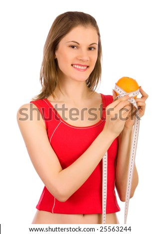 Beautiful girl holding an orange and a measure tape; isolated on white