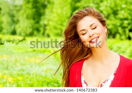 beautiful girl in a summer park